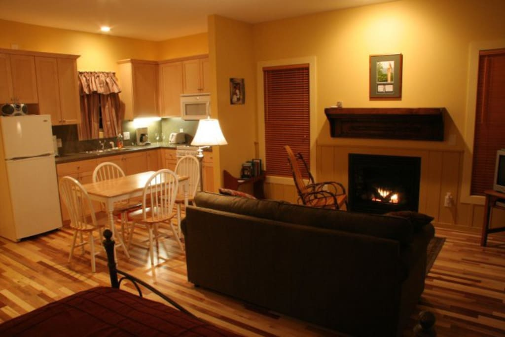The Hawk's Nest offers a refreshing yellow color scheme inside, with a loveseat that folds out to a full size bed, Satellite TV, gas fireplace, rocking chair, dinette, and complete kitchen with basic cooking and eating utensils.