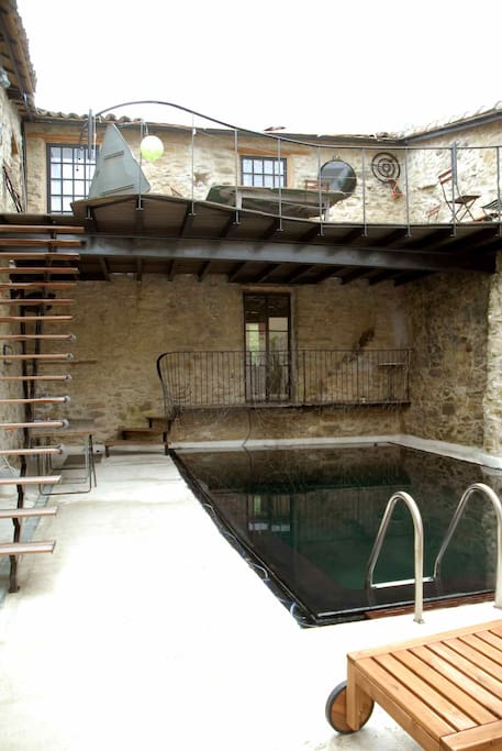 Pool with stairs leading upto the shared terrace with lounge chairs for catching the sun or an afternoon nap.