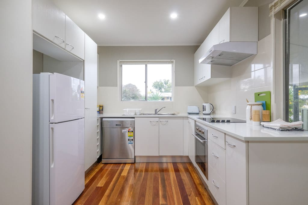 Kitchen with stainless steel appliances.