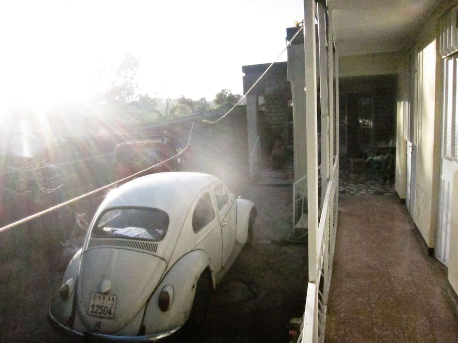 Our compound and house in late afternoon sun, rooms on the right, the red Niva is ours the Beedle is a guest.