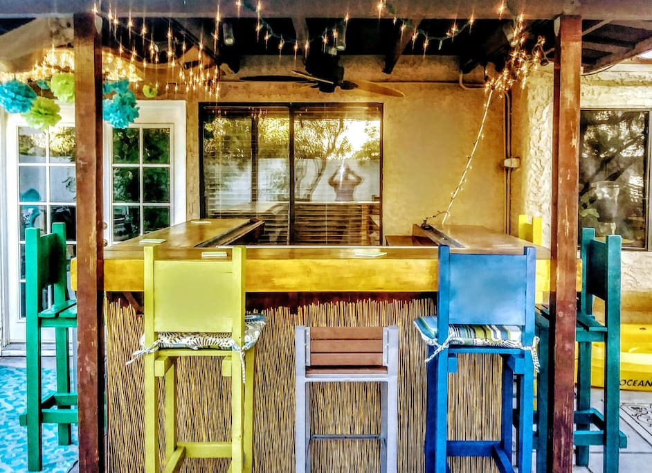Our amazing tiki bar is a terrific place to relax day or night.