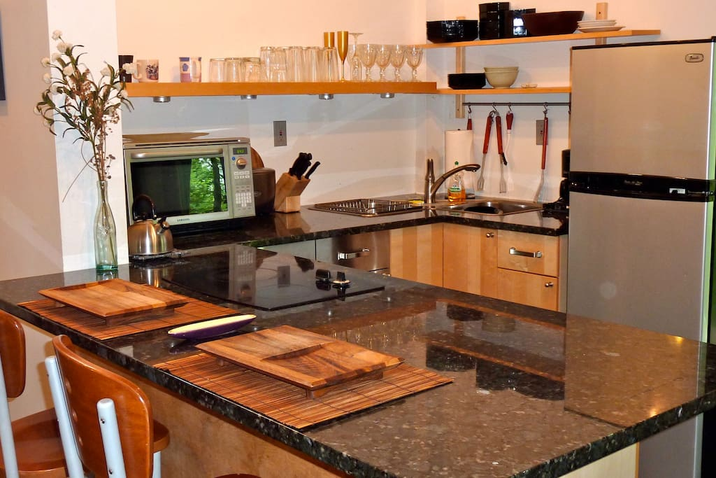 Fully stocked kitchen with marble countertops.
