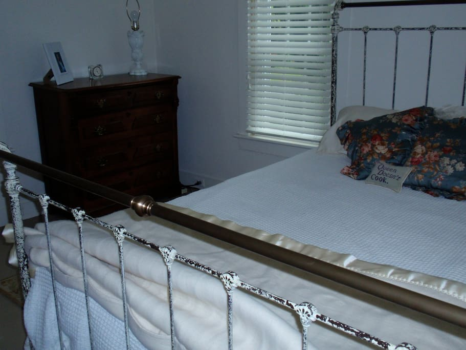 Bedroom with queen foam mattress and  antique furnishings.