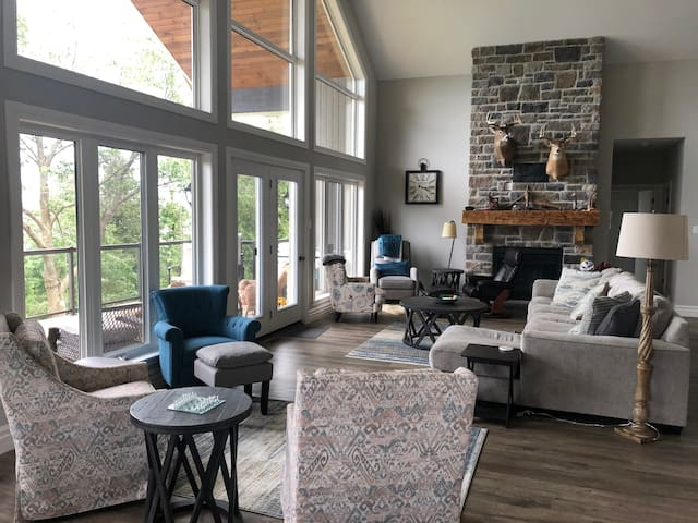 Great Room with gas fireplace and door to deck