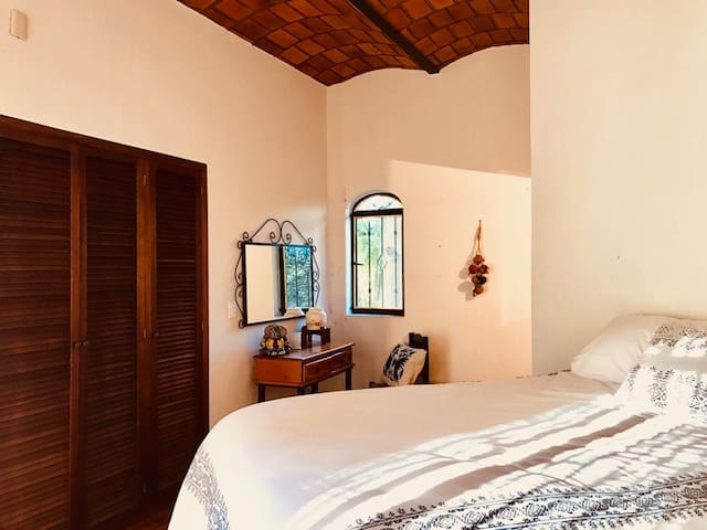 The enchanting master bedroom and full bath are located on the ground floor.