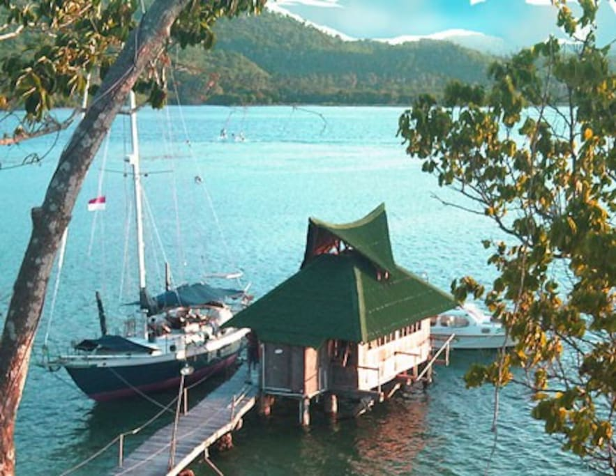 First picture of yacht docked by 'Bungalow over Reef'