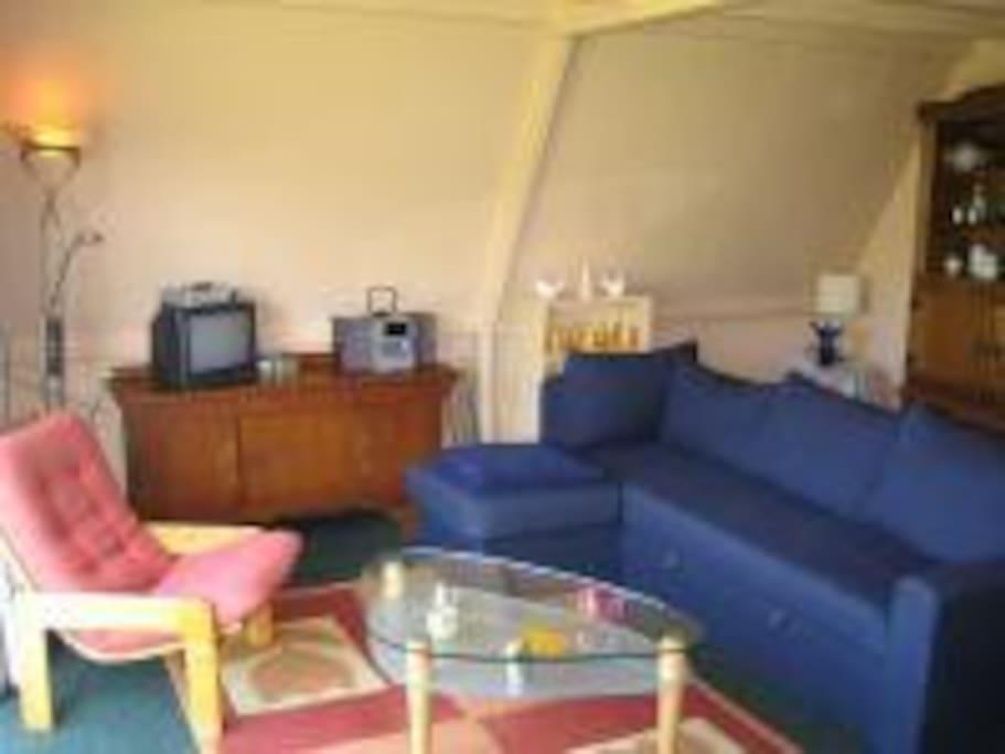 Binnen huiskamer bungalow.
