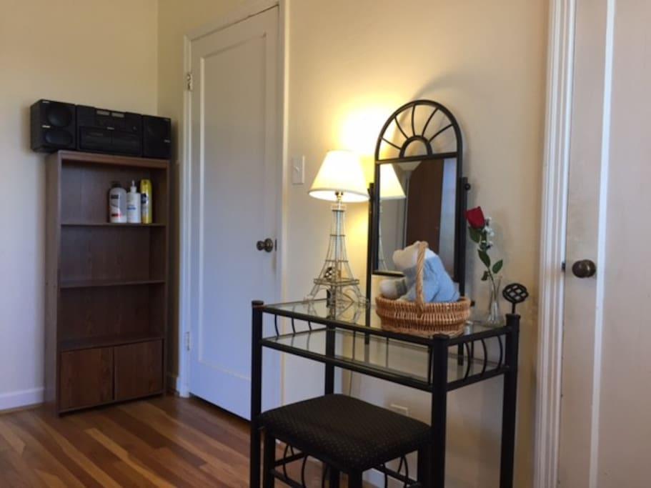 A bookshelf and a makeup table
