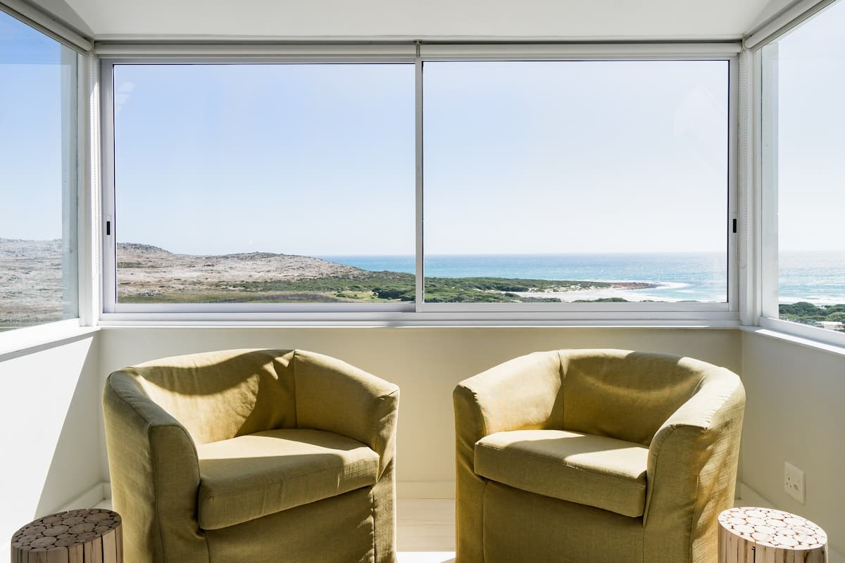 Walk to the Beach from a Stylish Home with Marvelous Views