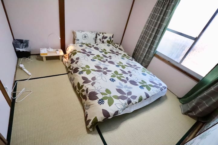 Room C  double bed 140*200 there is a balcony   you can add 1 tatami if more people use this house