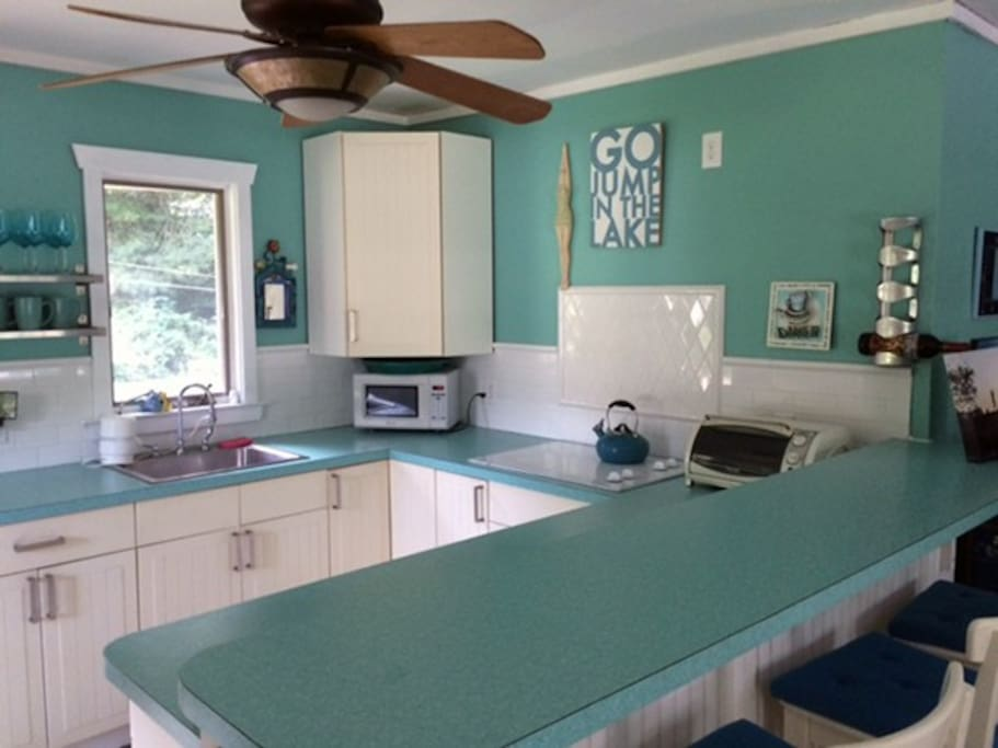 Kitchen includes a full-size fridge, cook top, toaster oven, and microwave. No oven!