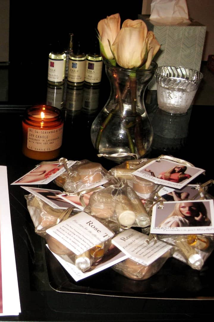 Scented oils, candle and fresh roses