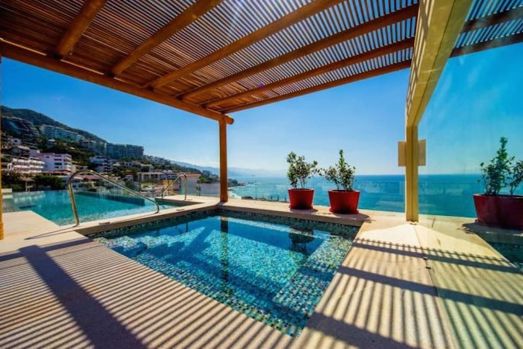 Beautiful rooftop infinity pool and hot tub, overlooking the bay.