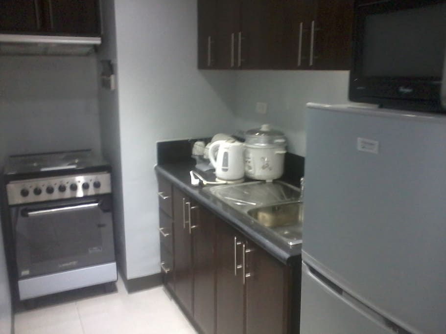 fully furnished kitchen complete with cutleries and washing machine
