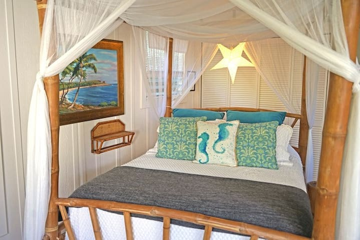 Moonrise Cottage bamboo canopy bed lends ambience and romance.