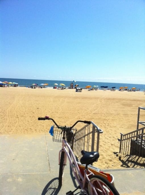 Access to the beach is just a few minutes walk down the street. Chair, umbrella, and kayak rentals available, life guard on duty, and an Oceanfront Bar/ Restaurant with a patio are some of the many amenities nearby. Boardwalk and State Park are a walkable
