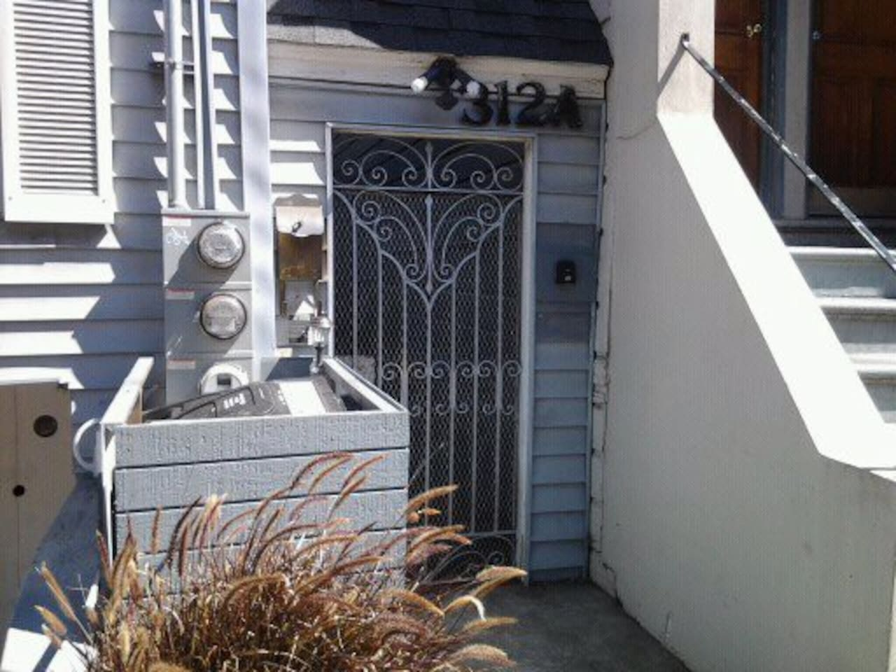 THIS IS THE GATE TO THE APARTMENT THE LOCK BOX IN ON THE RIGHT. LIGHT SWITCH ON THE LEFT PLEASE PRINT THIS PHOTO