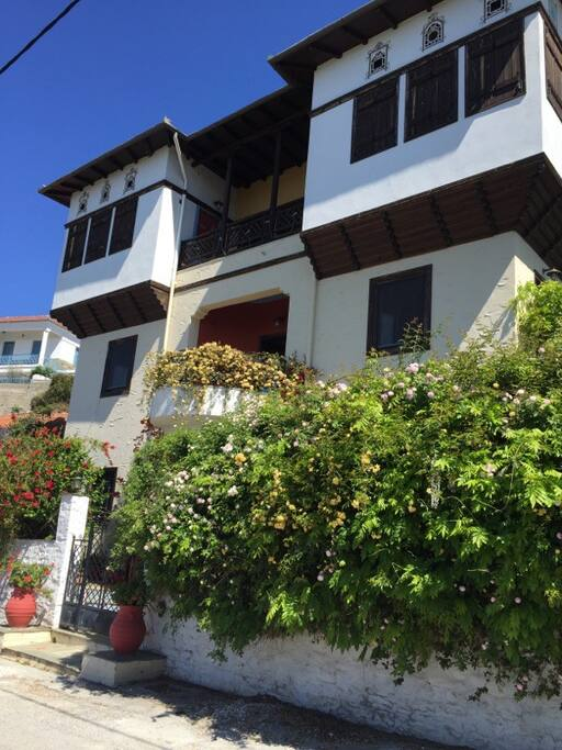 Traditional Pelion archontiko mansion in Trikeri, Greece. Beautiful gardens surround the home.