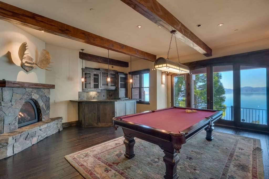 Lots of fun will be had in the billiards room, complete with a wet bar and one of the many fireplaces.