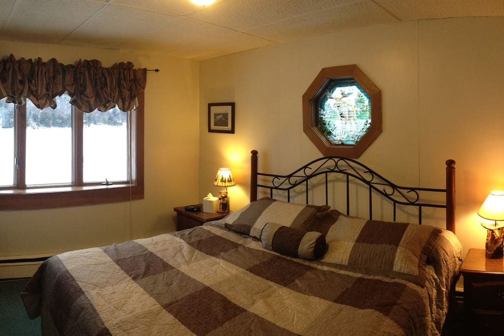 Our Adirondack Room, spectacular view of Big Moose Lake.  King Bed, Futon, TV, DVD, private bath.