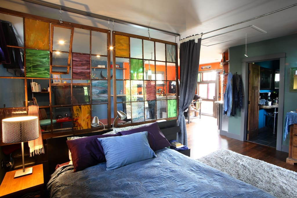 Queen bed, comfy sheets, super cool hanging windows room divider.  Curtains close to darken sleep space.