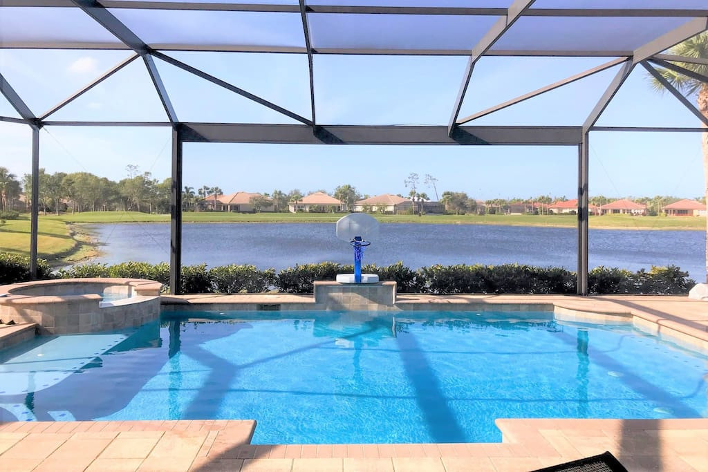 Large Lanai with Pool, Hot Tub, Grill, 2 Tables and Pool Lounge Chairs for Sun-Bathing
