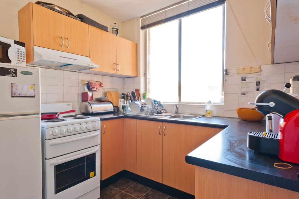 Kitchen with Microwave, Coffee Machine, Washer and Dryer