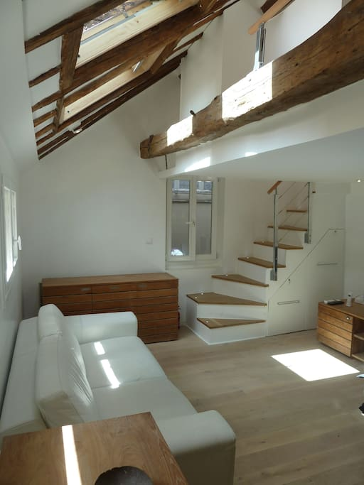 living room and stairs to upper level
