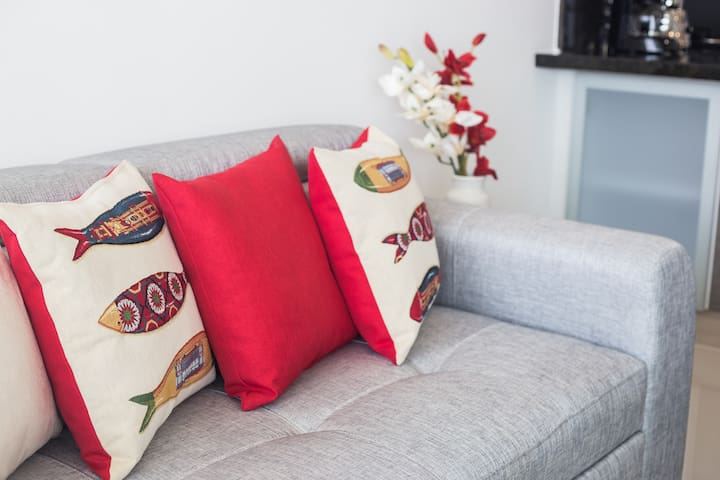 Open plan 1 bedroom apartment with A/C, TV, WiFi, Hot Water, Washing Machine, Dryer, Kitchenette & basic cleaning stuff, all you need in Cartagena! Enjoy the Sunset & Ocean view- Living Room