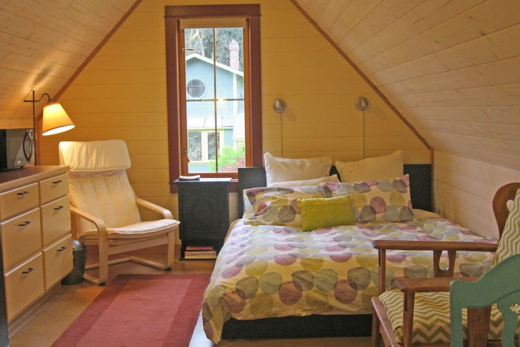 The charming studio has a comfy queen bed.