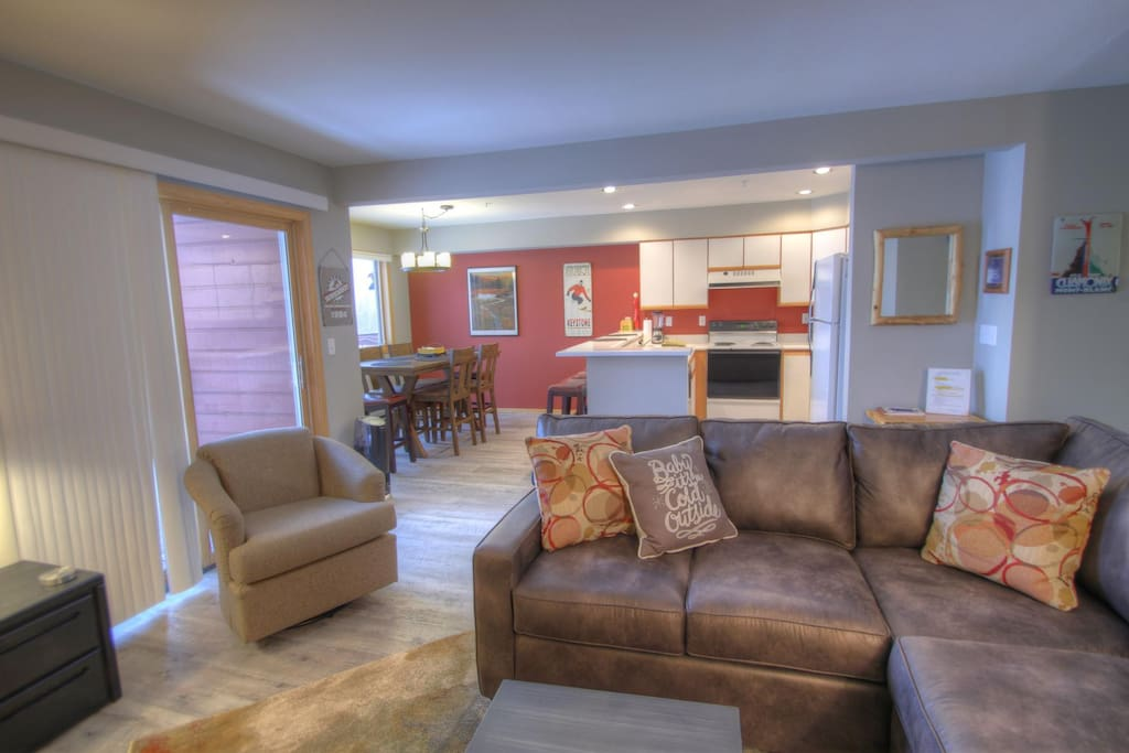 Living Room - The large sectional sofa pulls out to a double size bed to sleep 2 additional people.