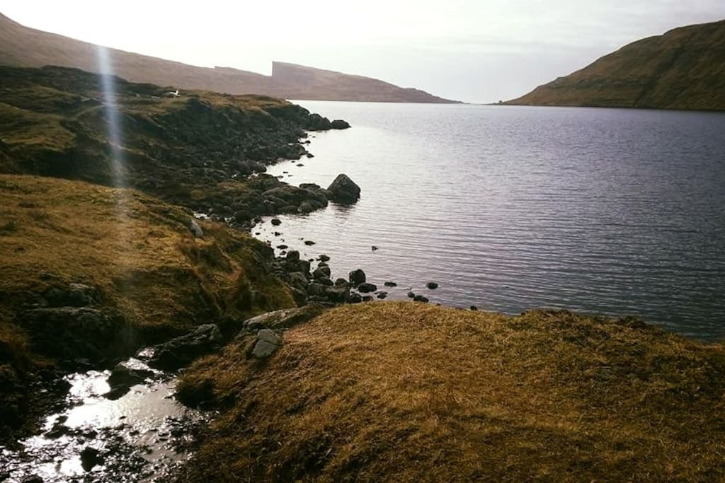 Hiking next to Leitisvatn, the largest lake on the Faroes.