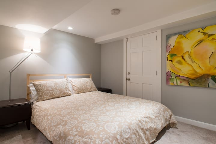 Queen bed in Suite , emergency exit located in this room