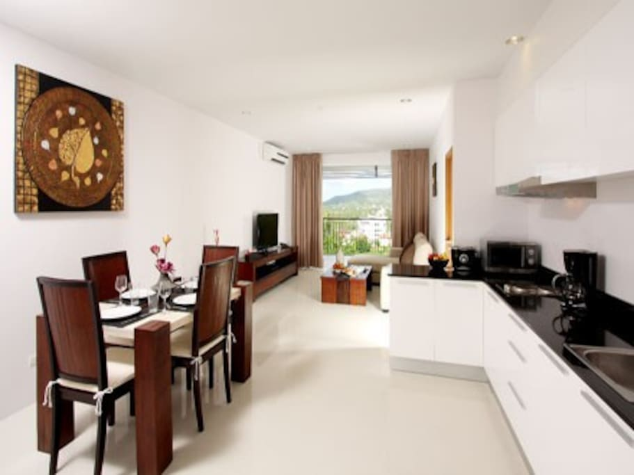 Dining, Kitchen & Living area leading to balcony