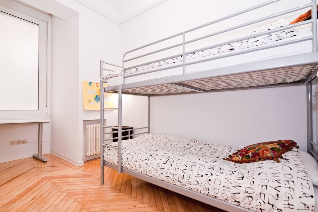 Room B: double bedroom with bunk bed and a big window (you may lower the blind to block out the sunlight)