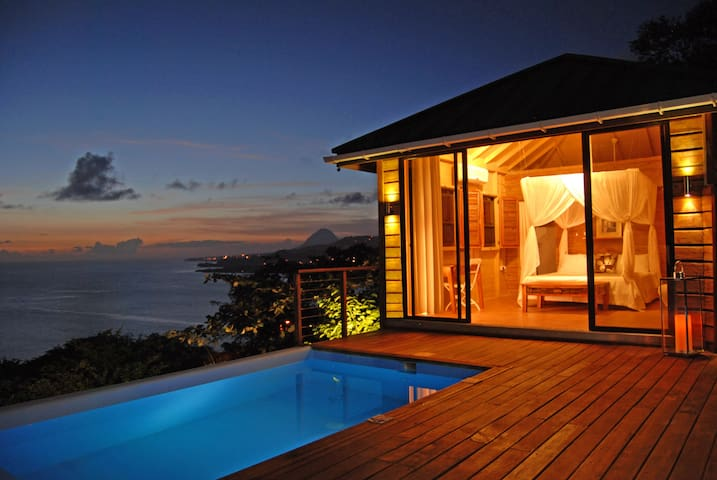 The romantic Caribbean-style cottage is detached from the main house and poolside