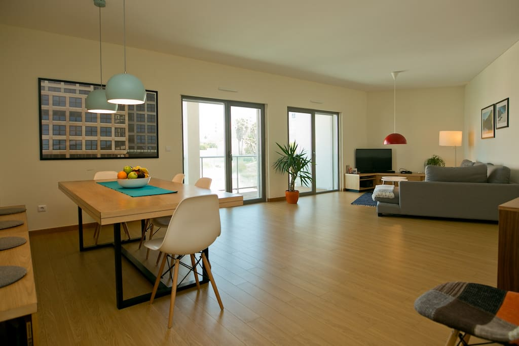 Big living room with dining area, sofa corner and easy accessible balcony
