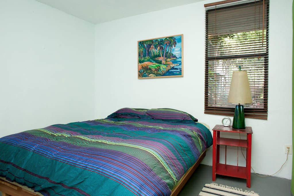 Bedroom has queen sized bed with Simmons Beautyrest mattress and large empty closet with lots of storage.
