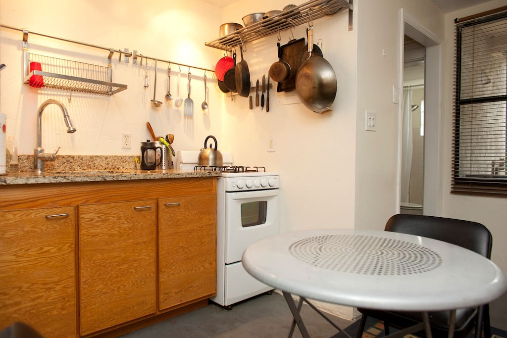 Gas stove and granite countertop.  Lots of IKEA. French coffee press available.