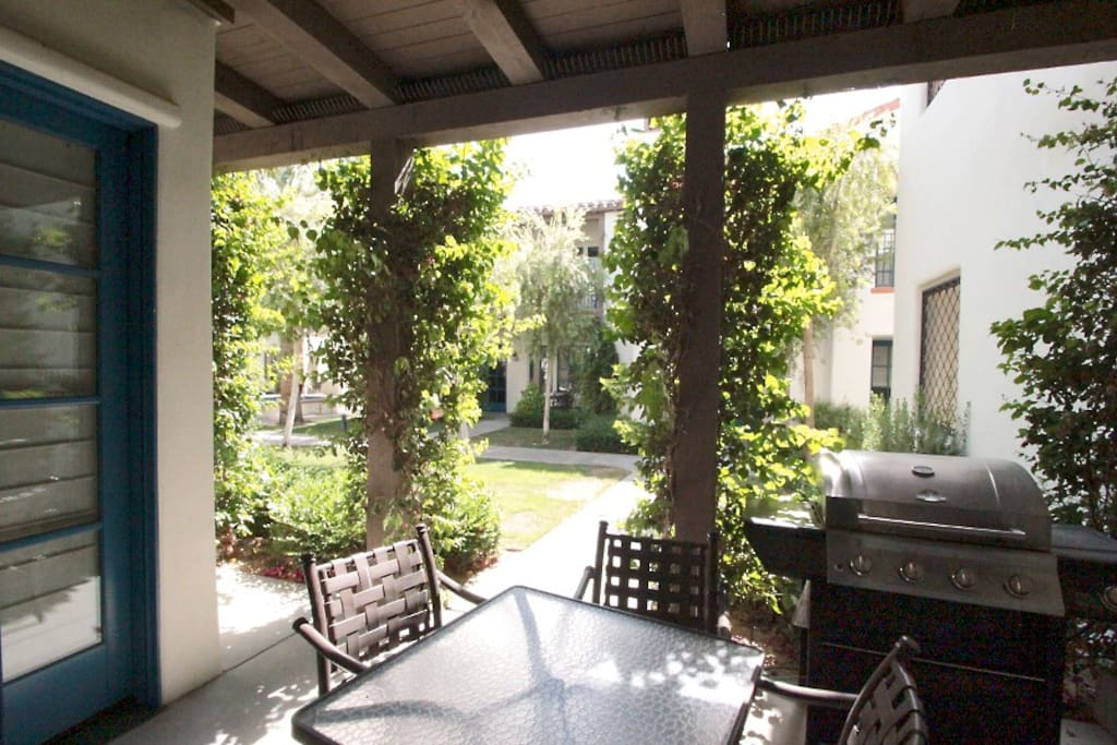Patio features a BBQ and table for alfresco dining.