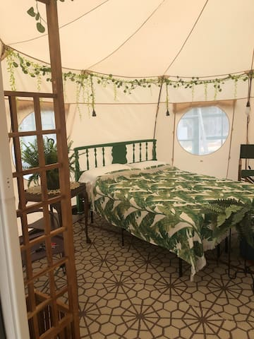 Larger Luna bell tent with double bed and twin bed