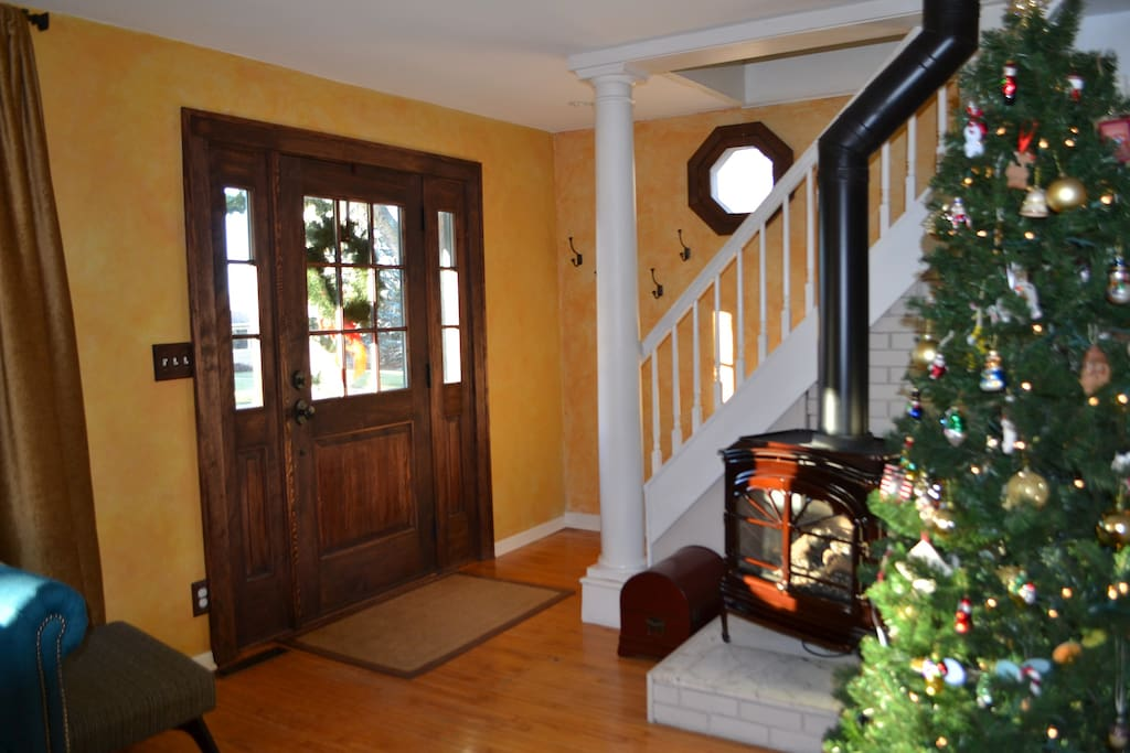 Inviting entrance with a gas fireplace