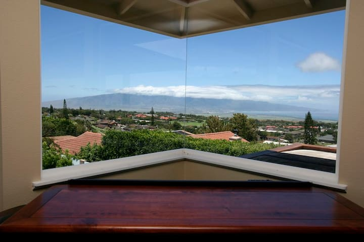 Corner window in living room shows off the views of the West Maui Mountains
