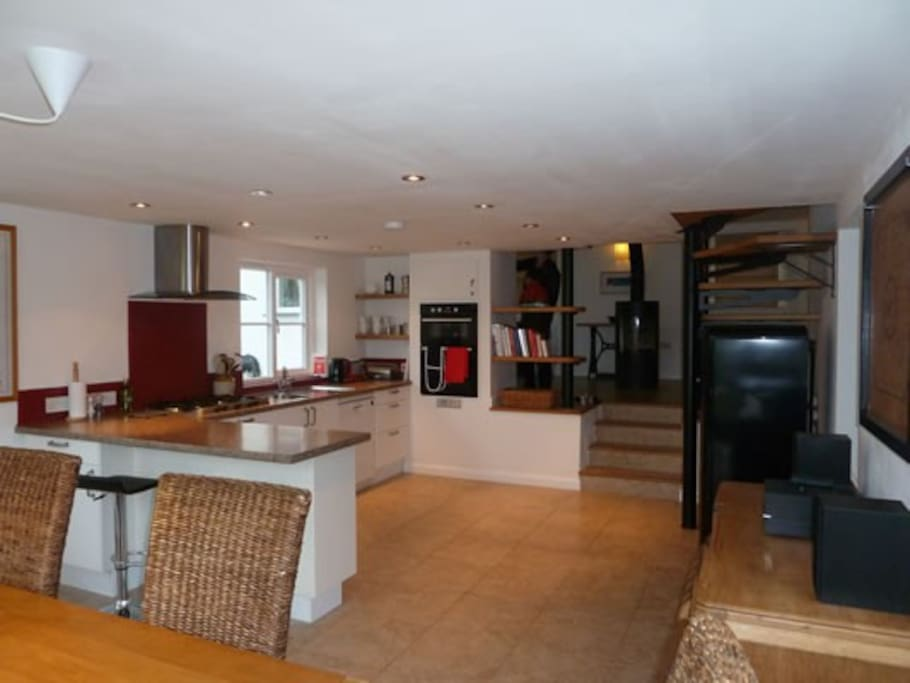 Open plan kitchen and dining area with french doors to garden