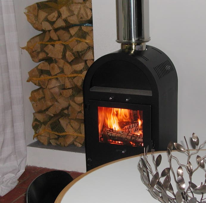 The stove for logs, one in each apartment