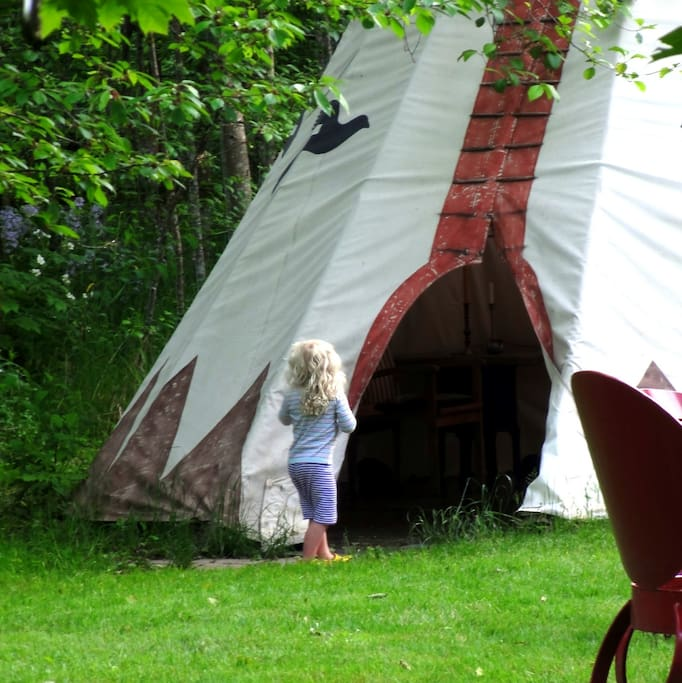 This is a 22 ft. tipi, and great for a family, right by the playing field. -Kids love tipis.
