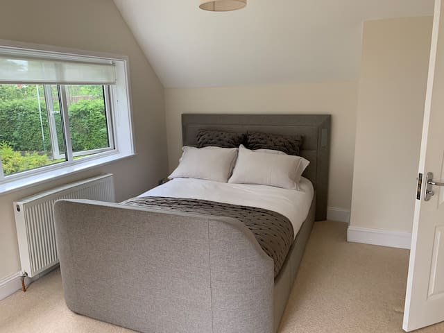 Luxurious King Bed Room with TV in Bed, Opening French Doors to Rear with Juliet Balcony