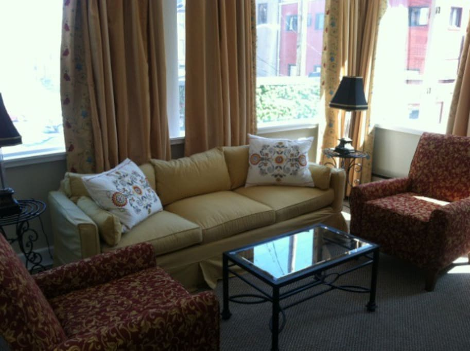 Fully enclosed sun porch features tons of natural light, perfect for reading and conversation