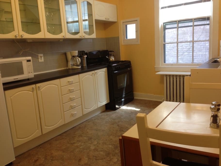 Eat in kitchen w Full size refrigerator and gas stove, microwave, coffee maker, toaster, blender