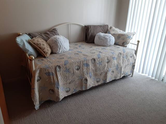 Bedroom 2: Day bed in bedroom on first level adjacent to bedroom 1 on first level.  This trundle expands to two twin beds that can be raised to the same sleeping level.
